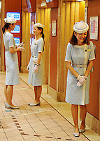 The uniformed lift attendants in a luxurious Tokyo department store.