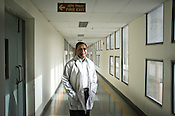 41 year old neurosurgeon, Dr. Deepak Agarwal poses for a portrait in the corridor of the Jai Prakash Narayan Apex Trauma Centre, AIIMS in New Delhi, India. Photo: Sanjit Das/Panos