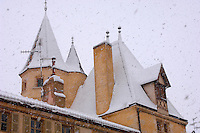 Typical Turrets on French rooves in the snow. Beaune. France