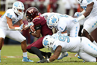 BLACKSBURG, VA - OCTOBER 19: Herndon Hooker #2 of Virginia Tech is sacked by Myles Dorn #1 and Aaron Crawford #92 of the University of North Carolina during a game between North Carolina and Virginia Tech at Lane Stadium on October 19, 2019 in Blacksburg, Virginia.