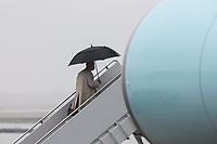"""United States President Joe Biden boards Air Force One in the rain at Joint Base Andrews on March 31, 2021 in Maryland. The President is traveling to Pittsburgh, Pennsylvania to deliver remarks on his economic vision for the future and the Biden-Harris administration's plan to """"Build Back Better"""" for the American people.<br /> CAP/MPI/RS<br /> ©RS/MPI/Capital Pictures"""