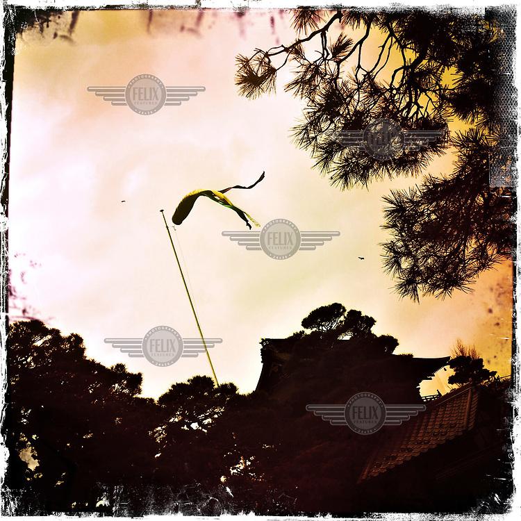 A flag flies at the Zenko-ji temple.