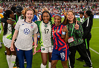 AUSTIN, TX - JUNE 16: Rose Lavelle #16, Francisca Ordega #17, Crystal Dunn #19 and Lauren Gregg pose for a photo during a game between Nigeria and USWNT at Q2 Stadium on June 16, 2021 in Austin, Texas.