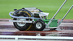 A machine removes water from the running track at Hampden Park<br /> <br /> Photographer Chris Vaughan/CameraSport<br /> <br /> 20th Commonwealth Games - Day 10 - Saturday 2nd August 2014 - Athletics - Hampden Park - Glasgow - UK
