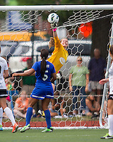 In a National Women's Soccer League Elite (NWSL) match, Portland Thorns FC defeated the Boston Breakers, 2-1, at Dilboy Stadium on July 21, 2013.  Boston Breakers goalkeeper Ashley Phillips (24) punches a corner kick away from the goal.