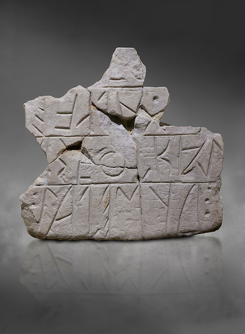 Stone stele fragment with a Phrygian written inscription. From Grodion . Phrygian Collection, 8th-7th century BC - Museum of Anatolian Civilisations Ankara Turkey. Against a grey background