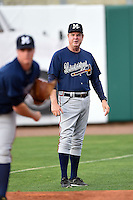 Mississippi Braves pitching coach Dennis Lewallyn (50) watches pitcher Jason Hursh (8) warm up before a game against the Montgomery Biscuits on April 21, 2014 at Riverwalk Stadium in Montgomery, Alabama.  Montgomery defeated Mississippi 6-2.  (Mike Janes/Four Seam Images)