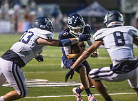 Greenwood quarterback LD Richmond is tackled by the Har-Ber defense in the first half of Friday's game at Greenwood.