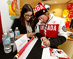 Ottawa, ON - March 28 2014- John Leslie of the para-snowboard team signs autographs at the CIBC Paralympic Welcome Home Event at CIBC South Keys Banking Centre in Ottawa (Photo: Patrick Doyle/CIBC)