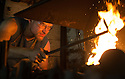 """01/07/15<br /> <br /> If you thought you were suffering in the heat at work today then spare a thought for this twenty-three-year-old, apprentice blacksmith whose workshop reached a staggering 118 degrees fahrenheit (47.7c) earlier today. <br /> <br /> Daniel Hawker from Mill Forge, Caudwell's Mill, Rowsley, Derbyshire said: """"Normally it reaches about 80 degrees, but this morning it's nearly 120 degrees. And it's likely to get hotter this afternoon when the sun heats up the south side of the building.<br /> <br /> """"Obviously, it's even hotter by the forge - the thermometer would probably explode if we measured the temperature there!  I'm used to the heat normally but this is really bad. I drink loads of water and I'll dip my feet in the canal at lunch time.<br /> <br /> """"I can open a couple of windows and the door but the fan doesn't work. It's stifling in here"""".<br /> <br /> <br /> All Rights Reserved: F Stop Press Ltd. +44(0)1335 418629   www.fstoppress.com."""