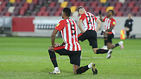 Ethan Pinnock of Brentford takes a knee ahead of kick-off during Brentford vs AFC Bournemouth, Sky Bet EFL Championship Football at the Brentford Community Stadium on 30th December 2020