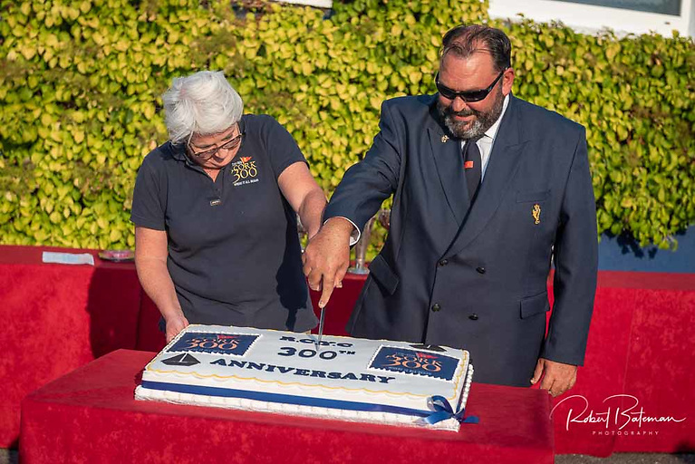 RCYC Admiral and Lady Admiral Colin and Irene Morehead cut the 300th birthday cake at Crosshaven Photo: Bob Bateman