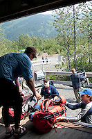 Returning campers and hikers load their gear at the Spencer Glacier Whistle Stop.
