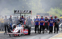 Aug. 7, 2011; Kent, WA, USA; NHRA top fuel dragster crew members for driver Shawn Langdon during the Northwest Nationals at Pacific Raceways. Mandatory Credit: Mark J. Rebilas-