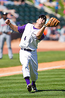 Third baseman Austin Yount #4 of the Winston-Salem Dash charges down the third base line to make a catch of a pop fly against the Kinston Indians at BB&T Ballpark on April 17, 2011 in Winston-Salem, North Carolina.   Photo by Brian Westerholt / Four Seam Images
