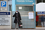 22/03/2020, Trento, Italy. Most part of Europe is today on a sweeping confinement to try to slow down the spread of the Covid-19 Pandemic. A woman wearing a mask and gloves is seen at the Santa Chiara Hospital of the Trentino Province in North Italy.