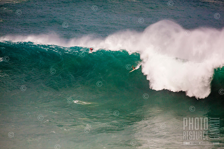 Surfer ride a wave at the 2016 Big Wave Eddie Aikau Contest, Waimea Bay, North Shore, O'ahu.