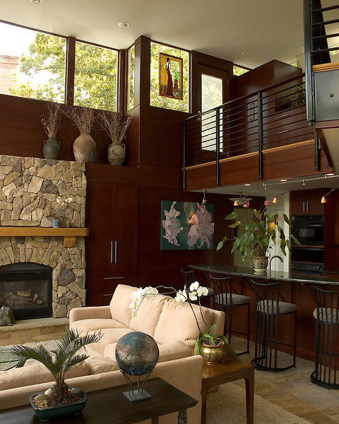 A  Modern great room addition in a Richmond, Virigina home.<br /> This is a view of the fireplace, kitchen, and 2nd floor cantilevered catwalk that leads to a rooftop porch overlooking the James River and the downtown Richmond skyline.
