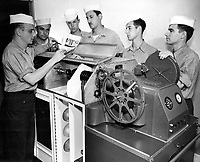 Class 4 Students at Naval School of Photography processing motion picture film.  Instructor Materna, PhoM 3/c, Houston KIA, 16 mm continuous processing machine.
