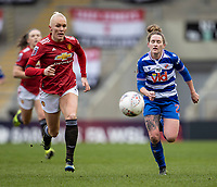 7th February 2021; Leigh Sports Village, Lancashire, England; Women's English Super League, Manchester United Women versus Reading Women; Maria Thorisdottir of Manchester United Women and Rachel Rowe of Reading chase down a lose ball