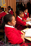 K-8 Parochial School Bronx New York Grade 5 students listening in class vertical
