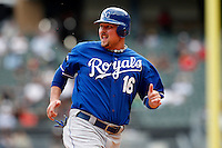 Kansas City Royals first baseman Billy Butler #16 looks for the ball as he heads to third during a game against the Chicago White Sox at U.S. Cellular Field on August 14, 2011 in Chicago, Illinois.  Chicago defeated Kansas City 6-2.  (Mike Janes/Four Seam Images)