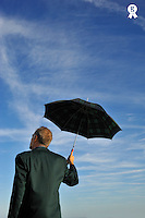 Businessman looking at sky, holding umbrella (Licence this image exclusively with Getty: http://www.gettyimages.com/detail/83676052 )