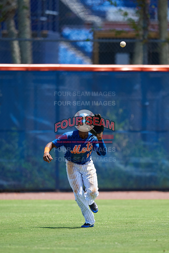 GCL Mets left fielder Wilmer Reyes (17) settles under a fly ball during a game against the GCL Marlins on August 3, 2018 at St. Lucie Sports Complex in Port St. Lucie, Florida.  GCL Mets defeated GCL Marlins 3-2.  (Mike Janes/Four Seam Images)