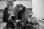 Chiswick Women's Aid, Richmond  London Uk 1975. Male helper Mike Dunn with children.