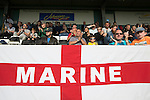 Marine 3 Ilkeston FC 1, 19/09/2015. The Mersey Travel Arena, Northern Premier League. Home supporters watching the second-half action at the Mersey Travel Arena, home to Marine Football Club (in white), as they played host to Ilkeston FC in a Northern Premier League premier division match. The match was won by the home side by 3 goals to 1 and was watched by a crowd of 398. Marine are baed in Crosby, Merseyside and have played at Rossett Park (now the Mersey Travel Arena)  since 1903, the club having been formed in 1894.  Photo by Colin McPherson.