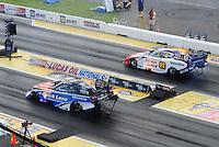Aug. 21, 2011; Brainerd, MN, USA: NHRA funny car driver Bob Tasca III (near lane) races alongside Johnny Gray during the Lucas Oil Nationals at Brainerd International Raceway. Mandatory Credit: Mark J. Rebilas-