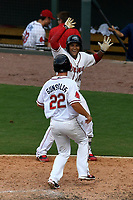 Roldani Baldwin (16) celebrates a Greenville Drive walk-off win as Mitchel Gunsolus crosses the plate today with the game winner on a Santiago Espinal hit in a game against the Rome Braves on Sunday, August 13, 2017, at Fluor Field at the West End in Greenville, South Carolina. Greenville won, 2-1. (Tom Priddy/Four Seam Images)