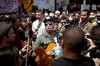 Guitarist Tom Morello, of Rage Against the Machine fame, performs during a NATO Summit Protest on Sunday, May 20, 2012, at Grant Park in Chicago. (Photo by James Brosher)