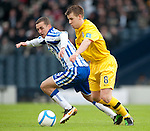 GLASGOW, SCOTLAND - JANUARY 28: Kilmarnock's James Fowler and Ayr United's Jamie McKernon during the Scottish Communities Cup Semi Final match between Ayr United and Kilmarnock at Hampden Park on January 28, 2012 in Glasgow, United Kingdom. (Photo by Rob Casey/Getty Images).