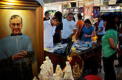 Shoppers seen at a stall selling Catholic figures at the Glorietta mall in the city of Makati in the Philippines. Photo: Sanjit Das