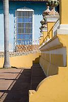 Windows and bench seats on Plaza Mayor, Trinidad, Sancti Spiritus, Cuba.