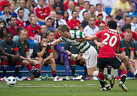 July 16, 2010 Fabio Da Silva No. 20 of Manchester United and Mark Wilson No. 12 of Celtic FC  during an international friendly between Manchester United and Celtic FC at the Rogers Centre in Toronto.