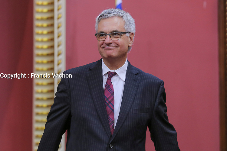 Jean-Marc Fournier is sworn in as Ministre responsable des Relations canadiennes et de la Francophonie canadienne and Leader parlementaire (minister of Canadian relationship and Francophony) of the new Liberal cabinet at the National Assembly in Quebec city October 11, 2017.<br /> <br /> PHOTO :  Francis Vachon - Agence Quebec Presse