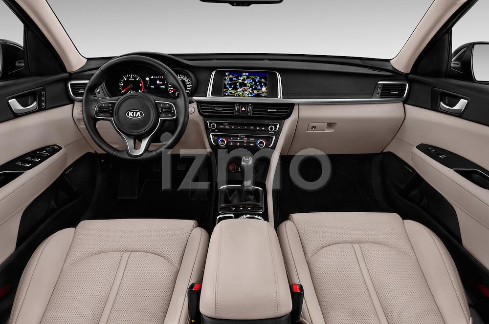 Stock photo of straight dashboard view of 2016 KIA Optima Sense 4 Door Sedan Dashboard