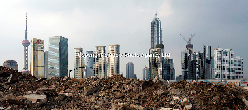 The Pudong skyline seen from the debris of an old neighborhood demolished for redevelopment in Shanghai, China..04 Jul 2006