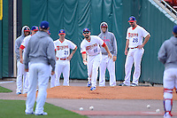 Buffalo Bisons catcher Mike Nickeas (16) attempts to get the ball on home plate in the bullpen as Bobby Korecky (29), Mickey Storey (7 in hoodie) and Buddy Carlyle (26) look on during a game against the Pawtucket Red Sox on August 4, 2013 at Coca-Cola Field in Buffalo, New York.  Pawtucket defeated Buffalo 8-1.  (Mike Janes/Four Seam Images)