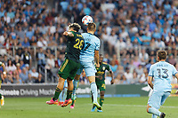 ST PAUL, MN - JULY 24: Robin Lod #17 of Minnesota United FC and Pablo Bonilla #28 of the Portland Timbers battle for the header during a game between Portland Timbers and Minnesota United FC at Allianz Field on July 24, 2021 in St Paul, Minnesota.