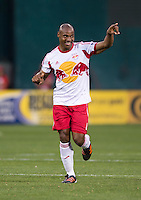 Jamison Olave (4) of New York Red Bulls celebrates his goal during the game at RFK Stadium in Washington, DC.  New York Red Bulls defeated D.C. United, 2-0.