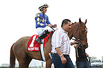 It's Me Mom with jockey Willie Martinez and connections after winning the Florida Sunshine Millions Fillies and Mares Sprint at Gulfstream Park. Hallandale Beach, Florida. 01-28-2012