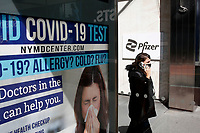 NEW YORK - NEW YORK - MARCH 23: A woman walks in front of Pfizer World Headquarters on March 23, 2021 in New York. The Food and Drug Administration (FDA) says Pfizer's coronavirus vaccine can be stored in normal freezers for two weeks, instead of storage at ultra-cold temperatures. (Photo by John Smith/VIEWpress)