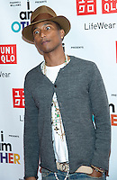 """NEW YORK CITY, NY, USA - APRIL 28: Recording Artist Pharrell Williams at the Pharrell Williams UNIQLO """"I Am Other"""" Collection Launch held at the UNIQLO New York 5th Avenue Global Flagship Store on April 28, 2014 in New York City, New York, United States. (Photo by Jeffery Duran/Celebrity Monitor)"""