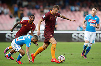 Calcio, Serie A: Napoli vs Roma. Napoli, stadio San Paolo, 15 ottobre. <br /> Roma's Edin Dzeko, right, is challenged by Napoli's Lorenzo Insigne during the Italian Serie A football match between Napoli and Roma at Naples' San Paolo stadium, 15 October 2016. Roma won 3-1.<br /> UPDATE IMAGES PRESS/Isabella Bonotto