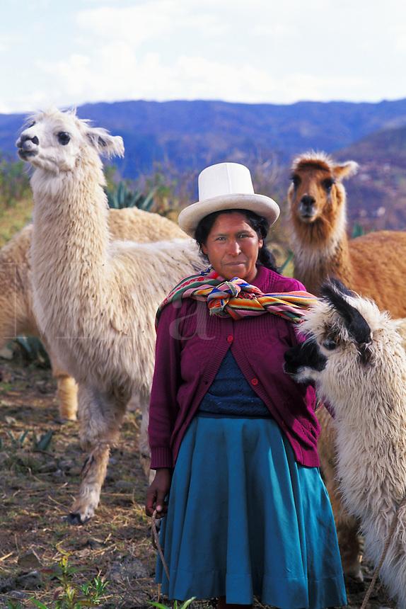 Colorful portrait of woman in costume with llama in costume Cuzco, Peru