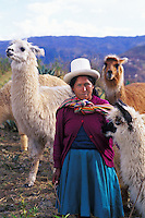 Colorful portrait of woman in costume with llama in costume Cuzco, Peru