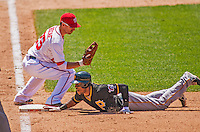 25 July 2013: Washington Nationals first baseman Adam LaRoche makes a pickoff attempt at first during a game against the Pittsburgh Pirates at Nationals Park in Washington, DC. The Nationals salvaged the last game of their series, winning 9-7 ending their 6-game losing streak. Mandatory Credit: Ed Wolfstein Photo *** RAW (NEF) Image File Available ***